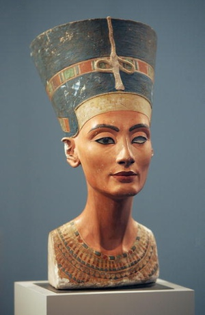 BERLIN - APRIL 16: The 3,400-year-old bust of Egyptian Queen Nefertiti stands on display at the Altes Museum April 16, 2007 in Berlin, Germany. Egypt and Germany are in a row over the bust after German Cultural Minister Bernd Neumann declined a request by the Egyptians to receive Nefertiti for a three-month temporary exhibit in Cairo. Neumann cited concerns over the limestone bust's ability to withstand such a long journey. In response Egyptian officials are threatening to ban any loan of its artifacts to museums in Germany. (Photo by Sean Gallup/Getty Images)